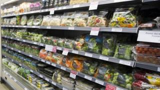 Shelves stacked with salad items