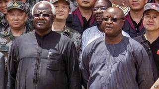 Sierra Leone' President Ernest Bai Koroma (left) and Vice-President Samuel Sam-Sumana at the opening ceremony of the China Friendship Hospital for Ebola patients in Freetown - 25 September 2015