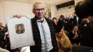 "The Swedish cartoonist, Lars Vilks, holds up his Danish Printing Society""s Sappho Prize, 14 March 2015"