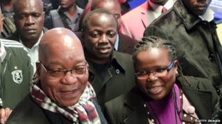 Collins Chabane pictured behind President Jacob Zuma in June 2012