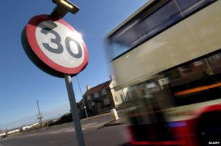 Bus passes 30mph speed limit sign