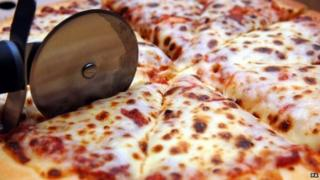pizza being sliced