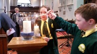 Candles lit at the service