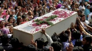 "Pakistani Christians carry a casket of a victim of Sunday""s pair of suicide attacks on two churches during a mass funeral service in Lahore, Pakistan"
