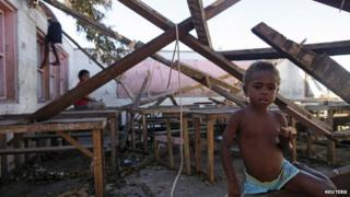 Children play in a destroyed school classroom in Tanna March 18, 2015.