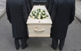 People holding a coffin