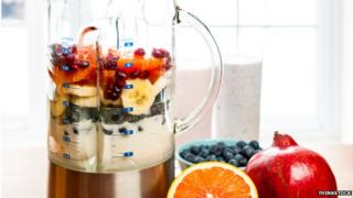A mixture of fruit in a blender