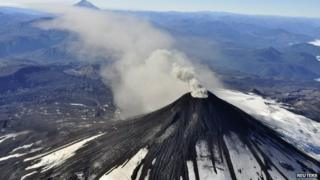 An aerial view shows smoke and ash rising from Villarrica Volcano on 18 March, 2015.