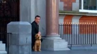 The man pretends to go to the toilet outside Newry City Hall