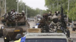 Chadian soldiers drive in the recently retaken town of Damasak, Nigeria, 18 March 2015.