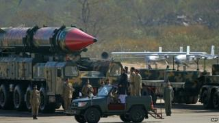 Pakistan's President Mamnoon Hussain (C) inspects a guard of honour alongside long-range Shaheen II ballistic missiles during the Pakistan Day military parade in Islamabad on March 23, 2015