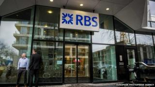 Two men standing outside an RBS branch
