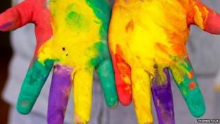 Paint-covered hands