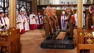 Richard III lowered into the ground