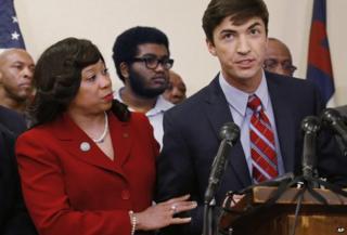 State Senator Anastasia Pittman standing beside Levi Pettit at the press conference