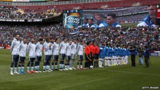 Argentina and El Salvador stand on the field during their national anthems during an International Friendly at FedExField