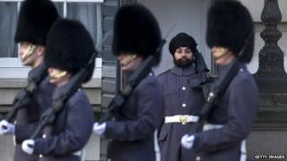A solider on guard duty wearing a turban