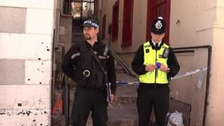 Officers stand guard near the scene in Gibraltar