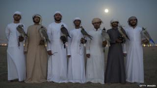 Emirati men with their falcons