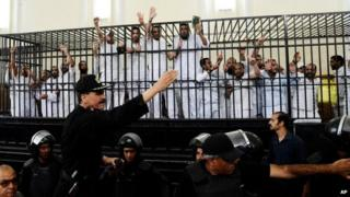 Defendants, some of them from the Muslim Brotherhood, receive sentences at a hearing in May 2014