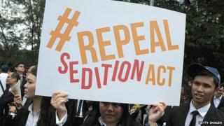 In a photo taken on 16 October 2014, a Malaysian Lawyer holding a placard outside the Parliament house during a rally to repeal the Sedition Act in Kuala Lump