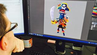 Midoki employee works on screenshot of Plunder Pirates