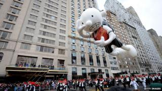 An inflatable Diary of a Wimpy Kid figure is flown at the Thanksgiving Day parade in New York