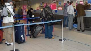 Passengers checking-in at Luton Airport