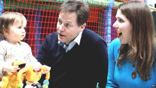 """Nick Clegg and East Dunbartonshire MP Jo Swinson (right) play with 14-month-old Sophia O""""Driscoll from Glasgow"""