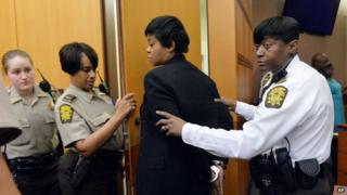 Tabeeka Jordan, a former school administrator, is led away in handcuffs after a jury found her guilty on 1 April 2015