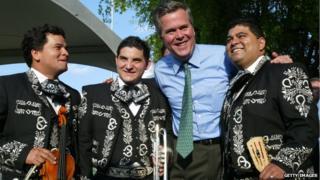 Governor Jeb Bush greets Mexican International Mariachi band members (L-R) Darwin Araujo, Alfredo Rojas and Douglas Cordero during a 'Florida - Mexico Cinco de Mayo Celebration: an Exchange of Cultures,' 5 May 2004