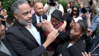 Anthony Ray Hinton is greeted by family outside the Jefferson County Jail in Birmingham, Alabama
