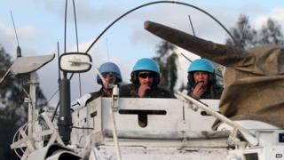 Spanish UN peacekeepers in an armoured vehicle patrol the Lebanese-Israeli border, in the southern village of Abbasiyeh, Lebanon (28 Jan 2015)