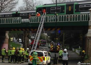 Lorry crashes into bridge carrying train