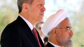 Iran's President Hassan Rouhani (R) stands next to Turkish President Recep Tayyip Erdogan