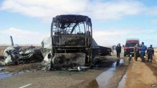 Remains of the burnt-out bus near Tan-Tan, Morocco, on 10 April 2015