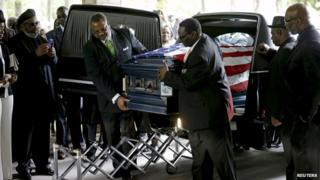 The casket of Walter Scott is removed from a hearse for his funeral at the Ministries Christian Centre on 11 April, 2015
