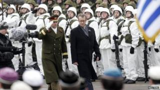 Estonian President Toomas Ilves inspects troops on independence day in Narva on the Russian border - 24 February
