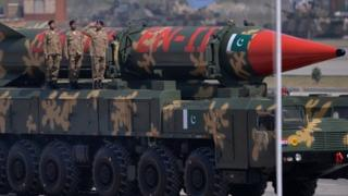Pakistani military personnel stand beside long-range ballistic Shaheen II missiles during the Pakistan Day military parade in Islamabad on March 23