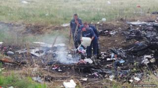 Water poured on remains of MH17 crash (July 2014)
