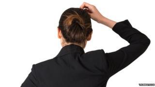 Woman scratching head