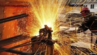 A worker welds at a construction site in China
