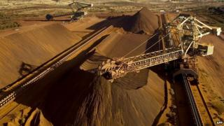 An undated handout photo released on September 4, 2009 by Rio Tinto shows a reclaimer working in the Yandicoogina stockyard and loading a conveyor with high grade iron ore in Western Australia's Pilbara region.