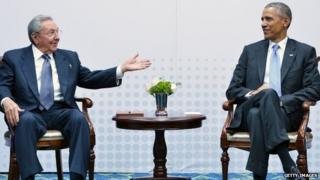 """Cuba""""s President Raul Castro (L) speaks during a meeting with US President Barack Obama on the sidelines of the Summit of the Americas at the ATLAPA Convention center on April 11, 2015 in Panama City."""