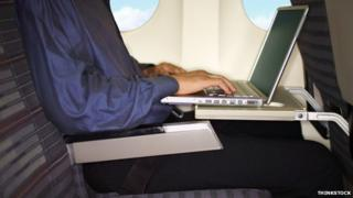 A generic picture of a laptop being used on a plane