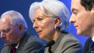 IMF Christine Lagarde holding a joint press conference with German Finance Minister Wolfgang Schauble (L) and British Chancellor of the Exchequer George Osborne (R)