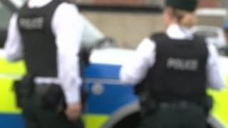 Blurry PSNI officers