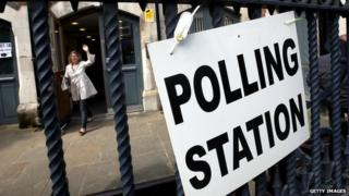 A woman leaves a polling station on Brick Lane, east London in the UK general election, 6 May 2010