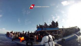 File photo: A boat of the Italian Guardia Costiera takes part in a rescue operation of migrants off the coast of Sicily, 12 April 2015