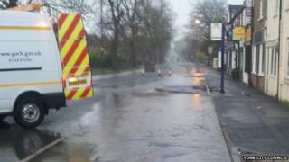 Water burst in road